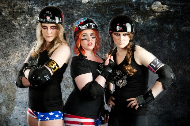 """""""I'm OK with how I look, and if a conference wants to photograph REAL roller derby players, then they should deal with the fact that they come in different shapes than a typical model,"""" said Copywriterher (center) of this photo that she feels undermines the spirit of the sport."""